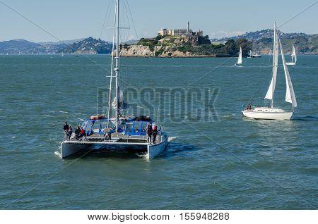 SAN FRANCISCO CALIFORNIA - MARCH 1 2015: Catamaran an Sail Boats at San Francisco Bay on Alcatraz Island background