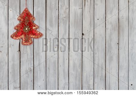 Sparkling Christmas Tree Velvet Ornament on Weathered Wooden Background