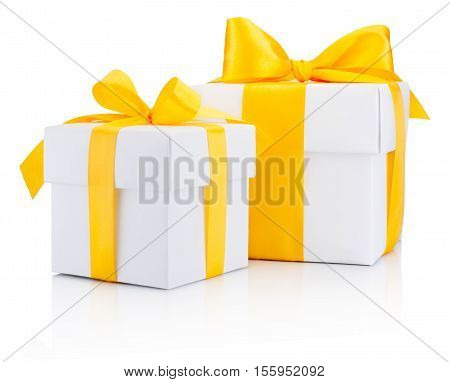 Two white gift boxs tied a yellow satin ribbon bow Isolated on white background