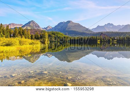 Among the high green mountains there is a lake and on its bed swim a lot of small fishes. A fantastic sight.Strbske Pleso lake Slovakia Tatra mountains