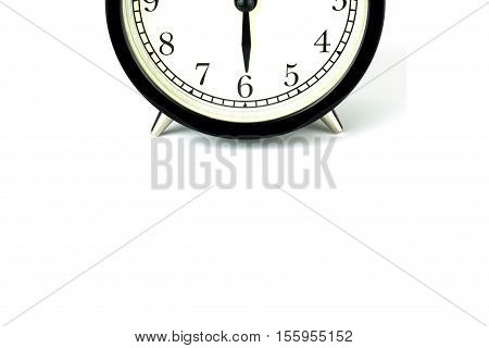 Alarm Clock on white showing six o'clock.