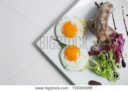 fried scrambled eggs with sausages; omelette with salad leaves and grilled meat;