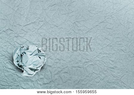 Crumpled paper ball on crumpled paper for backgrounds or textures