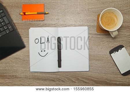 Open notebook with Portuguese words