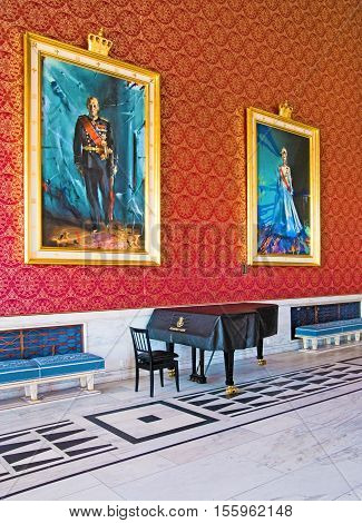 OSLO, NORWAY - APRIL 12, 2010: The banquet hall in City Hall of Oslo. The portraits of King of Norway Harald V and Queen of Norway Sonja