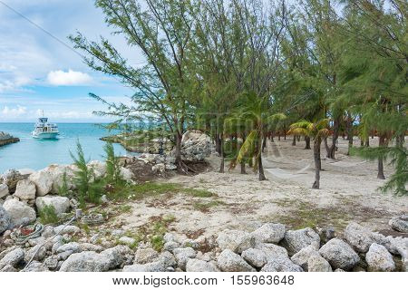 Hammocks, Beach, Ocean, And A Boat