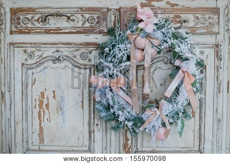 Christmas decoration on ancient vintage old commode chest of drawers