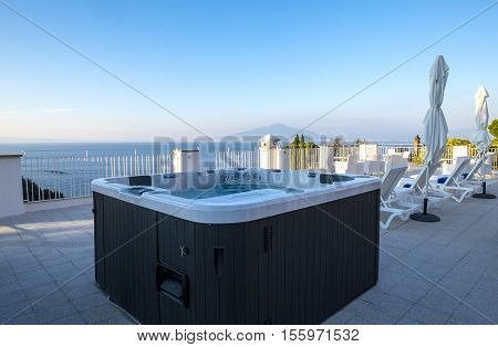 Hot Tub in a Resort Roof Top Overlooking the Mediterranean Sea and Mount Vesuvius, Sorrento, Italy