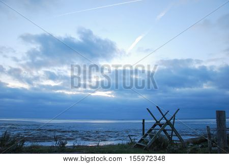 Wooden stile at a footpath along the coast of the swedish island Oland in the Baltic Sea
