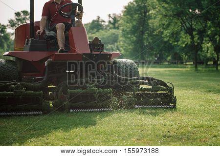 Golf course maintenance equipment fairway mower, toned image
