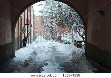 STOCKHOLM SWEDEN - NOV 10 2016: Snow chaos in the city and buildings in the background. November 10 2016 in Stockholm Sweden