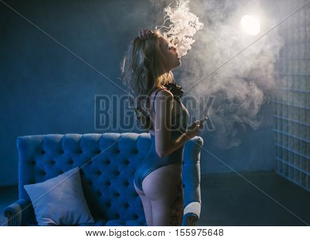 Portrait Of Sexy Woman In Lingerie Vaping E-cigarette , Vape Mod Concept