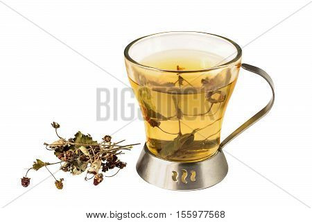 Useful tea with dried woodland strawberry (fragaria vesca) isolated on a white background. Used in healthy nutrition and herbal medicine