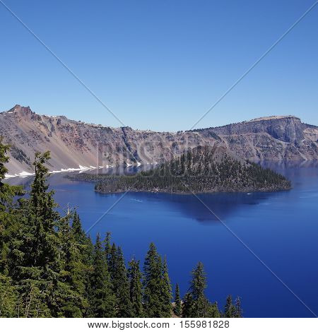 Wizard Island sits in Crater Lake on a sunny summer day.