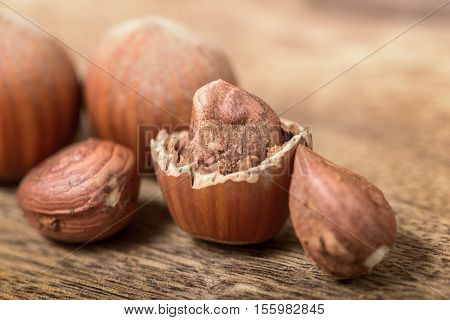 macro hazelnut and nutshell on wooden table