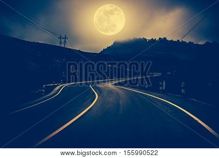 Landscape Of Nighttime With Curvy Roadway At National Park.  Vintage And Dark Tone.