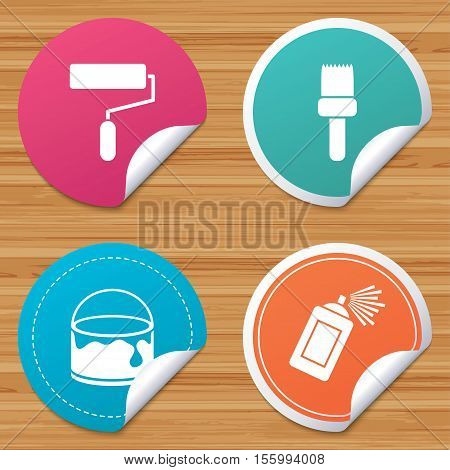 Round stickers or website banners. Painting roller, brush icons. Spray can and Bucket of paint signs. Wall repair tool and painting symbol. Circle badges with bended corner. Vector