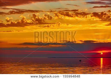The good red sunset over darken sea.