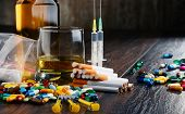 Variety of addictive substances including alcohol cigarettes and drugs poster