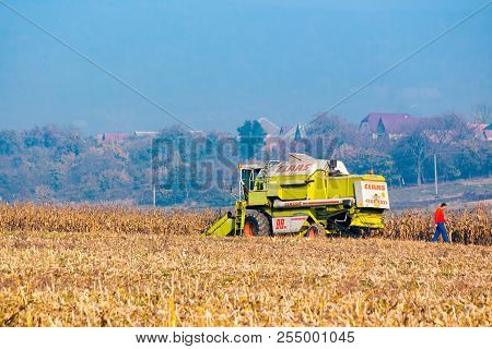 Shyroke, Ukraine - Nov 11, 2015: Broken Combine Harvester In The Corn Field Near The Village. Combin