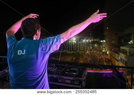 The Dj Stirs The Audience With Raised Hands And Arms To Greet Fans During A Musical Performance Outd