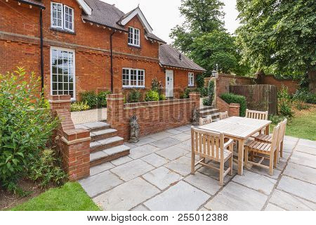 Large Historic Victorian House Featuring An English Garden And Patio With Wooden Furniture. Buckingh