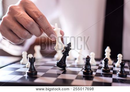 Hand Of Confident Businessman Use King Chess Piece White Playing Chess Game To Crash Overthrow The O