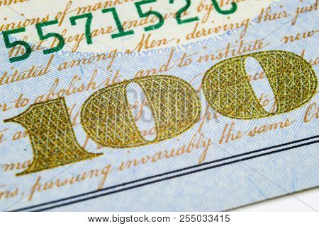 Macro Shot Image Of The Corner Of A 100 Dollar Bill Banknotes. Concept Of Financial Success. Backgro