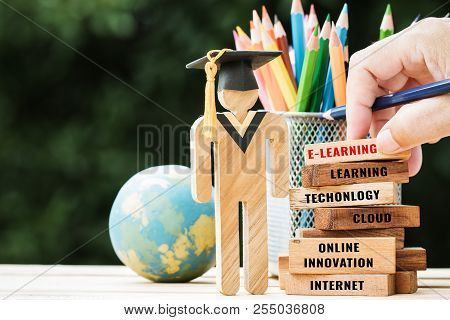 Blur Hand Placing Student Wood With Graduation Celebrating Cap On Wooden Blocks Tower Space For Lett