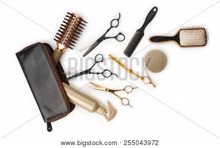 Essential Hair Dresser Tools With Leather Bag On White Background