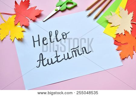 Hello Autumn Concept. Making Maple Leaf From Colored Paper With Your Own Hands For Decoration Of Gre