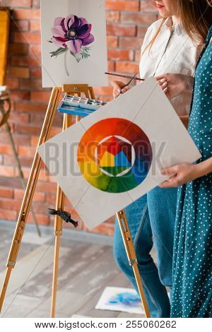 Painting Creativity And Skills Improvement. Woman Holding A Watercolor Palette Or Color Wheel. Drawi