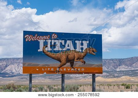 Dinosaur, Ut - June 22, 2018: Welcome To Utah State Border Sign Along Route 40 Along The Colorado-ut