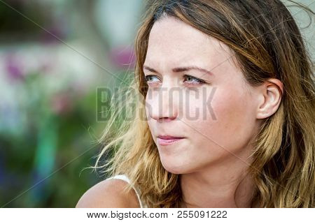 A Pensive Caucasian Girl Contemplating, Her Face Isolated Close Up Image.