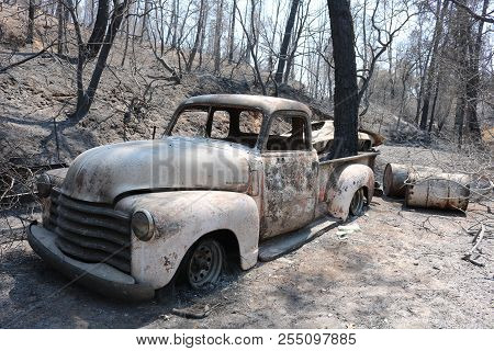 August 15, 2018 In Redding, Ca  Burnt Vintage Car Which Was In The Path Of The Carr Wildfire Which W