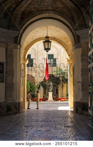 Valletta, Malta - May 2018: View From Arch Entrance Of Grandmaster Palace Courtyard With Maltese Fla