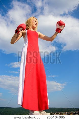Satisfied Free Girl Boxing Gloves. Femininity And Strength Balance. Woman Red Dress And Boxing Glove