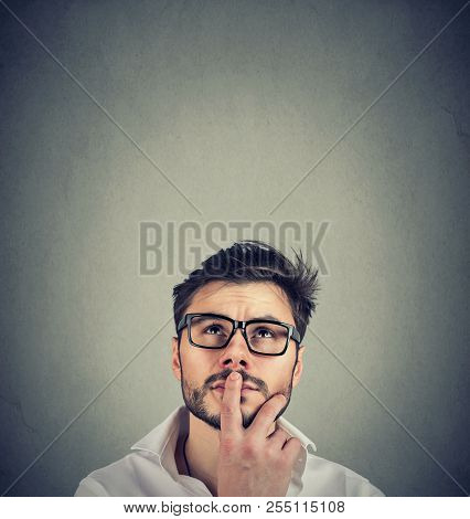 Closeup Of A Man Wondering Thinking Contemplating On Idea
