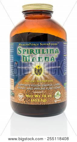 Winneconne, Wi - 23 August 2018: A Bottle Of Healthforce Spirulina Manna Supplement On An Isolated B
