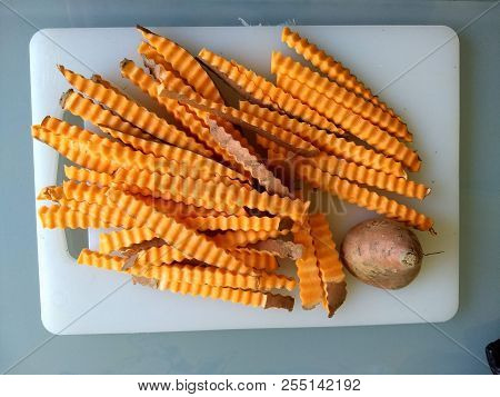 Making Healthy Food At Home Look Appetizing: Freshly Cut Sweet Potato Fries, Still Raw