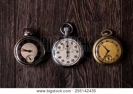Antique Pocket Watches On Brown Background