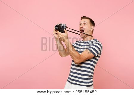 Portrait Of Smiling Young Photographer Man Wearing Striped T-shirt Take Pictures On Retro Vintage Ph