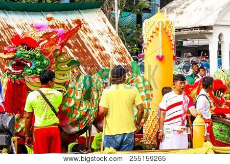 Samutsakorn, Thailand - July 27, Dragon And People In Big Boat Traditional Of Candles Parade To Temp