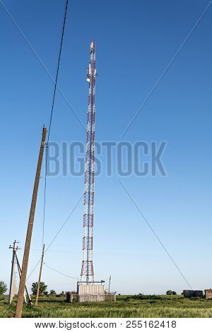 The Tower Of Cellular Communication On The Background Of The Blue Sky, Ukraine, The Village Of Shaga