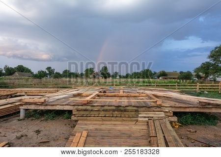 Base Frame House: Pile Foundation And Frame Template At Home After Rain