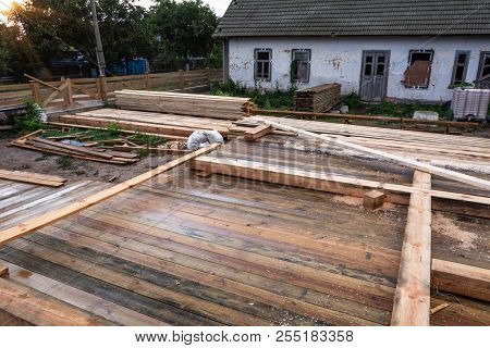 Blanks For The Construction Of A Frame House On The Background Of A Rural Landscape After A Rain At
