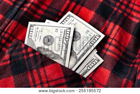 American Dollars, Hundred-dollar Notes, Sticking Out Of The Red Shirt Pocket. Pocket In Red Shirt Wi