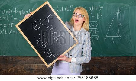 Woman Teacher Holds Blackboard Inscription Back To School. Looking Committed Teacher Complement Qual