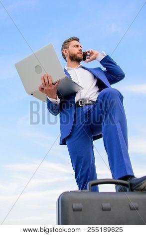 Man Well Groomed Businessman Holds Laptop Blue Sky Background. Confident Entrepreneur. Guy Formal Su