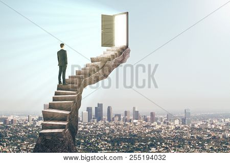 Man Standing On Stairs With Abstract Open Door. City Background. Dream, Exit And Success Concept. 3d